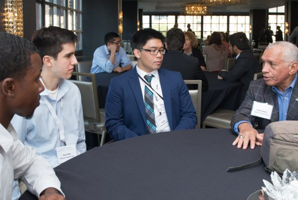 Young professionals speaking to former NASA Administrator Charlie Bolden during the conference's young professional speed-mentoring session hosted by the AAS. CREDIT/MARV SMITH, NASA GRC